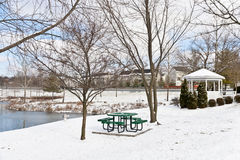 Winter city scene with a picnic table and gazebo. At neighborhood recreation area royalty free stock images