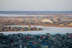 Winter city scenery with aerial view of Yakutsk downtown at twilight royalty free stock photography
