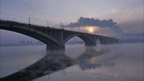 Winter cityscape, the automobile bridge in the backlight, time lapse stock footage