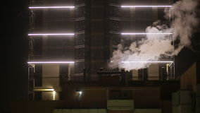 Winter cityscape. cranes. steam coming from the pipes. night. Winter cityscape. cranes and steam. snowing. steam coming from the pipes. night stock footage