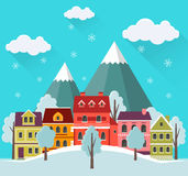Winter cityscape with falling snow. Royalty Free Stock Image