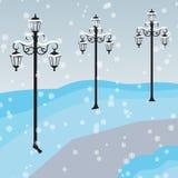 Winter cityscape with lanterns Stock Photos