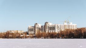 Winter Cityscape with modern buildings or houses and blue sky in sunny day Stock Images