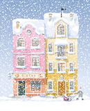 Winter cityscape. Old historical houses, shops and cafe at the snow-covered city street under snowfall