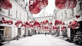 Winter cityscape with red balons and snow. Nice background for winter postcard Royalty Free Stock Photos