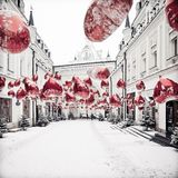 Winter cityscape with red balons and snow. Nice square background for winter postcard or SMM Royalty Free Stock Image