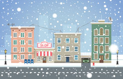 Winter cityscape. Snowfall in small town vector illustration. Stock Images