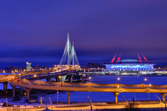 Winter cityscape with stadium, cable-stayed bridge and highway a Royalty Free Stock Photography