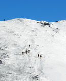 Winter climbing to the mountain range Royalty Free Stock Images