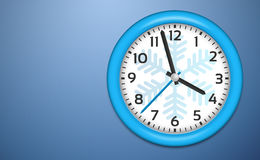 Winter Clocks on cold blue wall Stock Photography