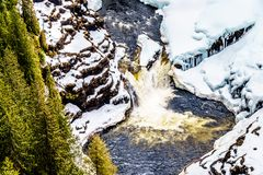 Winter close up of Lee Falls, the bottom portion of Helmcken Falls, on the snow covered Murtle River. In Wells Gray Provincial Park near the town of Clearwater stock photo