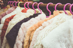 Winter cloth. Closeup of some used leather clothes hanging on a rack in a market royalty free stock images
