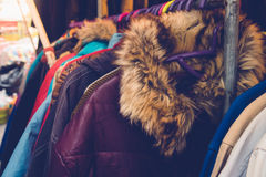 Winter cloth. Closeup of some used leather clothes hanging on a rack in a market stock photos