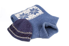 Winter clothes. Winter blue sweater and cap with  ornament isolated over white Stock Images