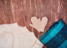 Winter clothes. Beautiful light ladies fashion on a wooden background. stock images
