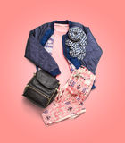 Winter clothes collection isolated on pink gradient background. Stock Images