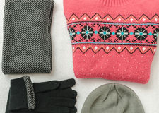 Winter clothes colored wool. Collar, gloves, hat, sweater. Winter clothes intensely colored wool. Neckcloth and sweater. Winter is coming. Top view Stock Photography