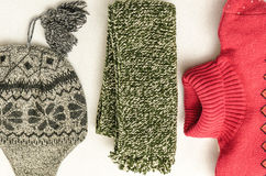 Winter clothes intensely colored wool. Collar, hat and sweater Royalty Free Stock Photos