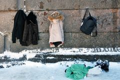 Winter clothes on the Peter and Paul`s fortess wall. Saint-Peteraburg, Russia. Those clothes are left by people who went swimming in the whole, winter swimming royalty free stock image