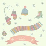 Winter clothes set scarf, mittens, hat, ice skates Royalty Free Stock Images