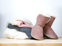 Winter clothes and shoes.Pair of uggs. Stock Photos