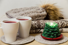 Winter clothes, two cups of mulled wine and candle Stock Image