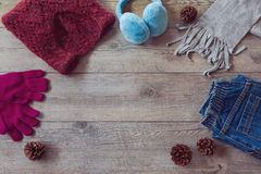 Winter clothes on wooden background. View from above with copy space Stock Photo