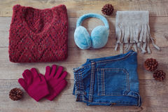Winter clothes on wooden background. View from above Stock Images