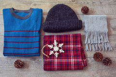 Winter clothes on wooden background. View from above Stock Image