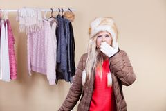 Woman in furry hat thinking what to wear Stock Photos