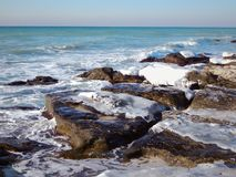 Winter coast of the Caspian Sea. Rocky winter coast of the Caspian Sea royalty free stock photos