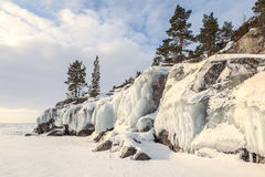 Winter, coast of the frozen lake In the sunny day. Stock Photos