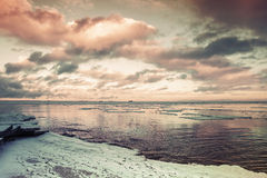 Winter coastal landscape with floating ice. Gulf of Finland Royalty Free Stock Images