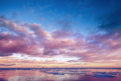 Winter coastal landscape with floating ice on sea water Stock Photos