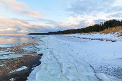 Winter coastal landscape with ice and snow on the beach Royalty Free Stock Photography