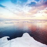 Winter coastal landscape with snow and ice stock photography