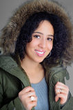 Winter Coat. Beautiful African American Young Woman Wearing A Fashion Winter Coat With Fur Trimmed Hood Stock Photos