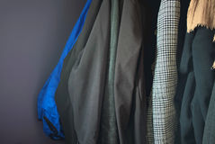Winter coats. Dark winter coats hanging in close up royalty free stock images