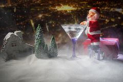 Winter Cocktail - Alcoholic drink and snow scene with a Christmas theme or Ideas and recipes for Christmas drink. Glass of martini stock photo
