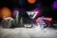 Winter Cocktail - Alcoholic drink and snow scene with a Christmas theme or Ideas and recipes for Christmas drink. Glass of martini stock photography