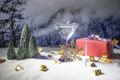 Winter Cocktail - Alcoholic drink and snow scene with a Christmas theme or Ideas and recipes for Christmas drink. Glass of martini stock images