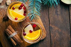 Winter Cocktail, Christmas Sangria with Apple Slices, Orange, Cranberry and Spices, Refreshing Drink. Winter Cocktail, Christmas Sangria with Apple Slices stock photos