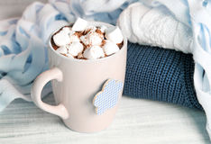 Winter cocoa marshmallow mug knitted sweater on wooden background. stock image