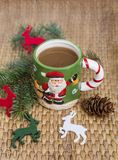 Winter coffee in a christmas mug with christmas deers. Coffee mug with pine cones and deers.Christmas festivities Royalty Free Stock Images
