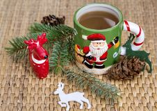 Winter Coffee in a Christmas Mug with Christmas Deers. Coffee mug with pine cones and deers.Christmas festivities Royalty Free Stock Image