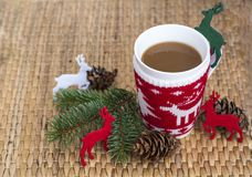 Winter coffee in a christmas mug with christmas deers. Coffee mug with pine cones and deers. Christmas festivities Stock Image