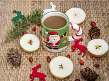 Winter Coffee in a Christmas Mug with Christmas Deers. Coffee mug with pine cones and deers.Christmas festivities Stock Photos
