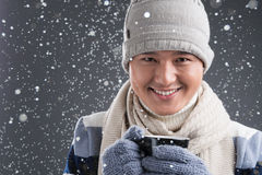 Winter coffee. Close-up portrait of a young man drinking hot coffee in winter Stock Photography
