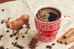 Winter coffee and deer. Coffee in red cup and deer Stock Photo