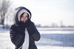 Winter cold. Women enjoying winter cold in a waterfront park Stock Image